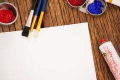 Watercolor paint and paint brushes and white paper Stock Photos