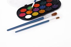 Watercolor paint palette and brushes Stock Image
