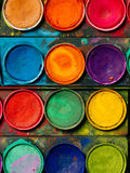 Watercolor paint palette. Photo of a palette of watercolor paints and well-used tray Stock Image