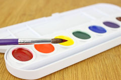 Watercolor paint set showing brush Stock Photos