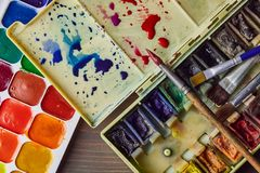 Watercolor paint on the table stock image