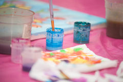 Watercolor paint on the table Royalty Free Stock Photo