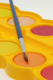 Watercolor paint tray and brush Stock Image