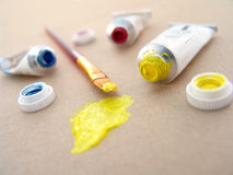 Watercolor paint tubes with brush Stock Photography