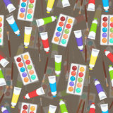 Watercolor, paint in tubes and brush seamless pattern, art background. Vector multicolored art supplies Royalty Free Stock Images