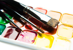 Watercolor paintbox and paintbrushes Stock Image