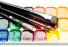 Watercolor paintbox and paintbrushes Royalty Free Stock Photos