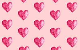 Watercolor painted background, seamless pattern with hearts. Watercolor painted background as a seamless pattern with hearts on pink. Can be used for different Stock Photo