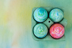 Watercolor painted Easter eggs. In egg box Royalty Free Stock Photos
