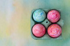 Watercolor painted Easter eggs. In egg box Stock Images