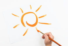 Watercolor painted sun and hand with brush Stock Photography