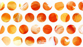 Watercolor painted texture with yellow, orange and red circles. Stock Image