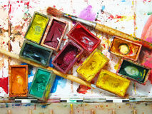 Watercolor painting and artistic tools on table Royalty Free Stock Photos