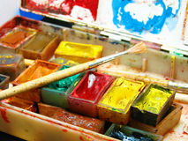 Watercolor painting and artistic tools on table Stock Images