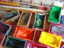 Watercolor painting and artistic tools on table Stock Photography
