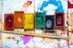 Watercolor painting and artistic tools on table Royalty Free Stock Photo