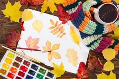 Watercolor painting with autumn leaves, paint, brushes and color Stock Photography