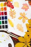 Watercolor painting with autumn leaves on wooden background. vector illustration