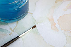 Watercolor painting. Closeup of a watercolor painting and a brush Stock Photography