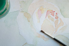 Watercolor painting. Closeup of a watercolor painting and a brush Stock Image