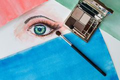 Watercolor painting of an eye, eye shadows and brush. Closeup of watercolor painting of an eye, eye shadows and make up brush Royalty Free Stock Photography