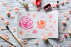 Watercolor painting with flowers on table. Watercolor painting with flowers on wooden table Royalty Free Stock Photos
