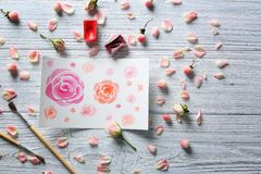 Watercolor painting with flowers on table. Watercolor painting with flowers on wooden table Royalty Free Stock Photography