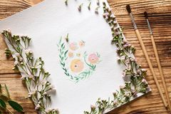 Watercolor painting with flowers on table. Watercolor painting with flowers on wooden table Stock Photos