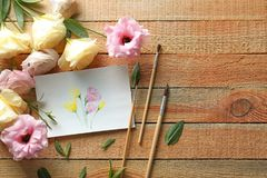 Watercolor painting with flowers on table. Watercolor painting with flowers on wooden table Stock Photography