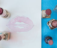 Watercolor painting of lips surrounded by lipsticks. Closeup of watercolor painting of lips surrounded by lipsticks Royalty Free Stock Photos