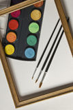 Watercolor painting set, wooden frame and brushes  on white album background. Royalty Free Stock Photography