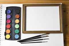Watercolor painting set, wooden frame and brushes  on white album background. Stock Photography