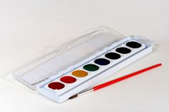 Watercolor Paints. Children's watercolor paints with brush, on a white background stock photography