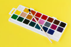 Watercolor paints in a box with a brush Royalty Free Stock Images