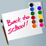 Watercolor paints in box with brush. inscription on the paper. Back to school. Vector Royalty Free Stock Image