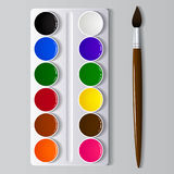 Watercolor paints in a box with a brush. Royalty Free Stock Photography