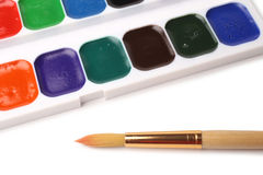 Watercolor paints in box and brush Royalty Free Stock Images