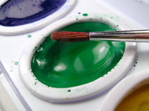 Watercolor Paints and Brush Stock Images