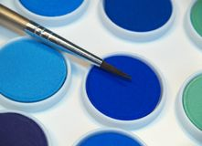 Watercolor paints and brush Royalty Free Stock Photo