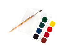 Watercolor paints with a brush Royalty Free Stock Photography