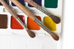 Watercolor paints and brushes Royalty Free Stock Images