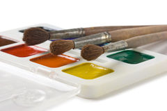 Watercolor paints and brushes Stock Photography