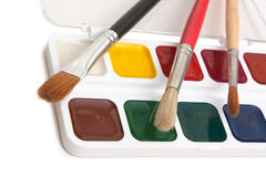 Watercolor paints and  brushes Stock Images