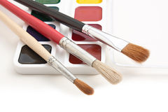 Watercolor paints and  brushes Stock Photo