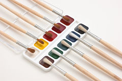 Watercolor paints and brushes Royalty Free Stock Image