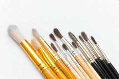 Watercolor paints of different colors with a wide range of brushes. Watercolor paints in a palette of different colors with a wide range of brushes of different Stock Photos