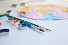 Watercolor paints and drawing supplies stock image