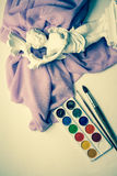 Watercolor paints. And lilac drapery Royalty Free Stock Photos