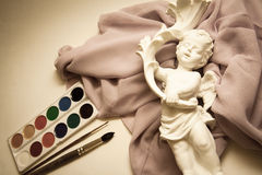 Watercolor paints. And lilac drapery Royalty Free Stock Photo