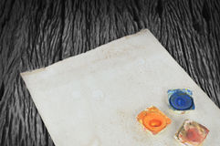 Watercolor paints and old paper Royalty Free Stock Images